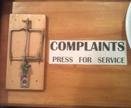 Complaints sign, with mouse trap!