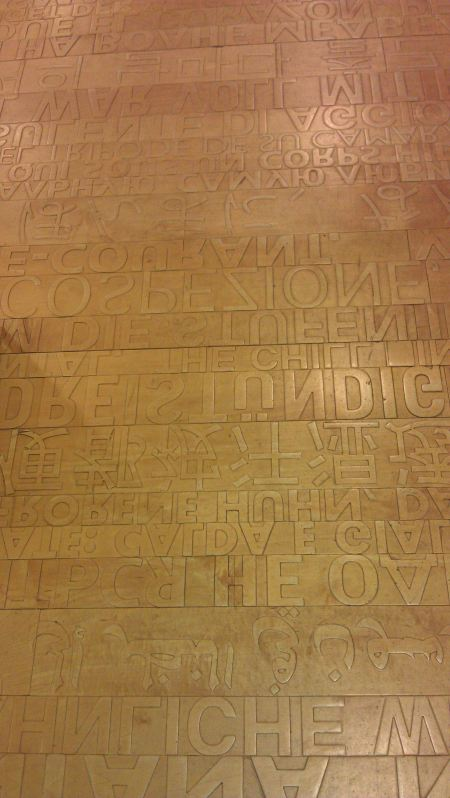 Amazing floor made of maple and the first sentences of the foreign language books - back-to-front