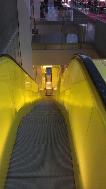 Two two-storey yellow escalators